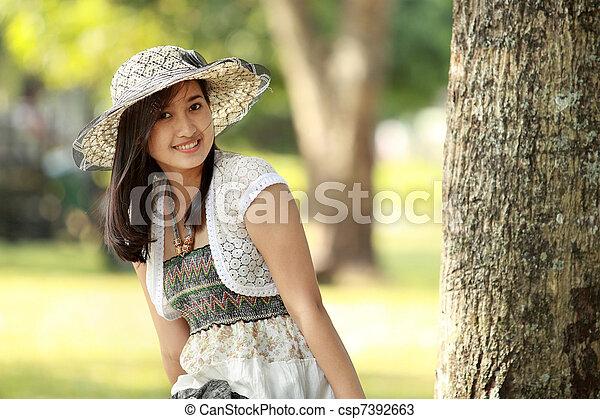 young beautiful asian woman smiling - csp7392663