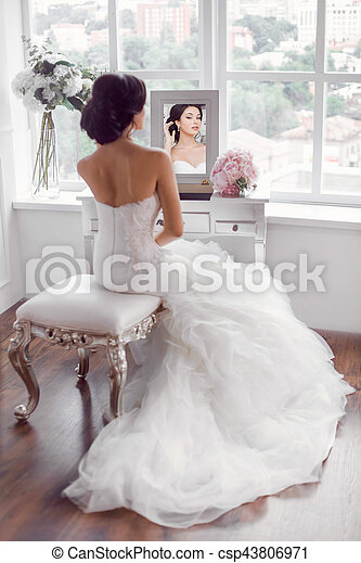 Young beautiful bride preparation at home. Wedding preparation ...