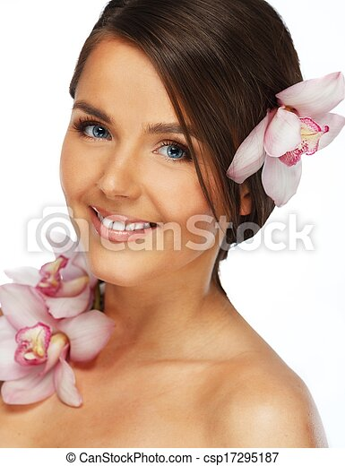 Young beautiful brunette woman with orchid flowers  - csp17295187