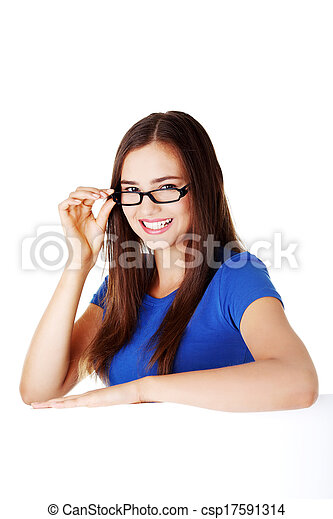 Young beautiful casual woman holding copy space. - csp17591314