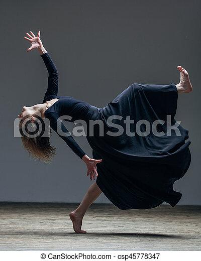 Young beautiful dancer is posing in studio - csp45778347