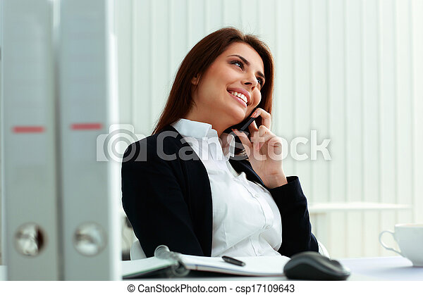 Young Beautiful Happy Businesswoman Talking On The Phone At Office