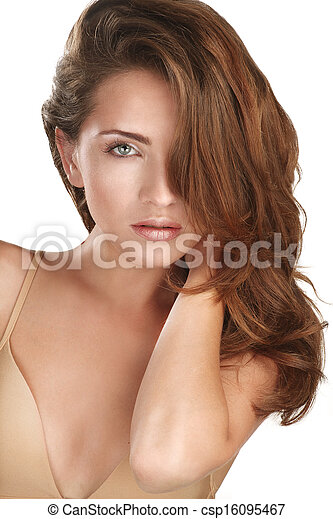 Young beautiful model showing her long red hair - csp16095467