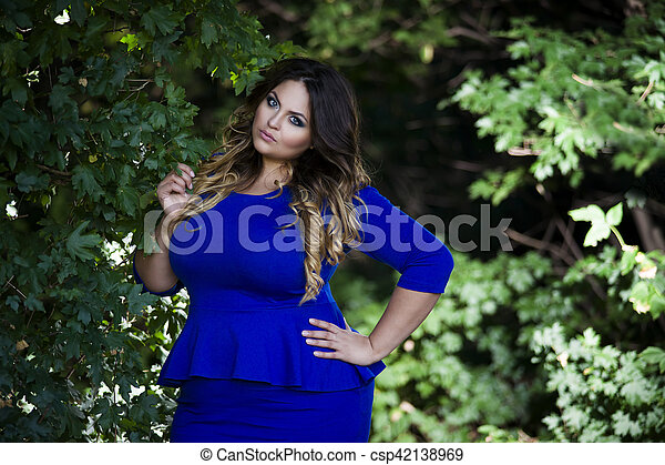 Young Beautiful Plus Size Model In Blue Dress Outdoors Xxl Woman On