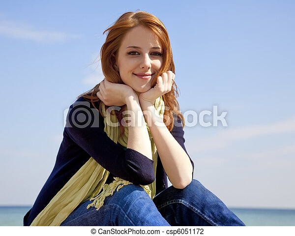 Young beautiful red-haired woman at the beach in spring time. - csp6051172