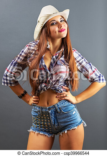 Young beautiful sexy girl in cowboy hat on grey background. - csp39966544 4dc2482e7c0