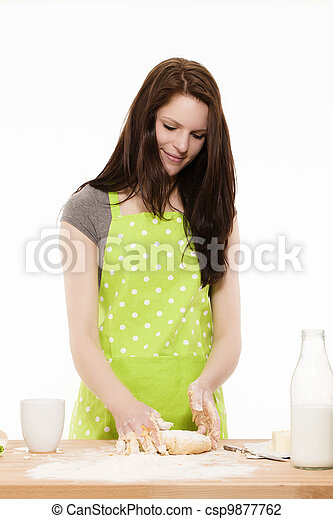 young beautiful woman forming dough on a table in front of white background - csp9877762