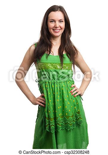 young beautiful woman in green dress smiling - csp32308248
