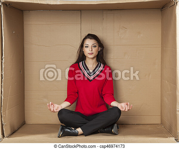Young beautiful woman sitting in a cardboard box office - csp46974173