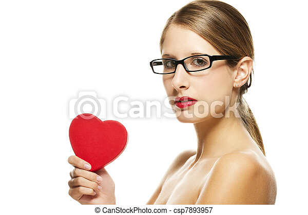 young beautiful woman with black glasses holding red heart on white background - csp7893957