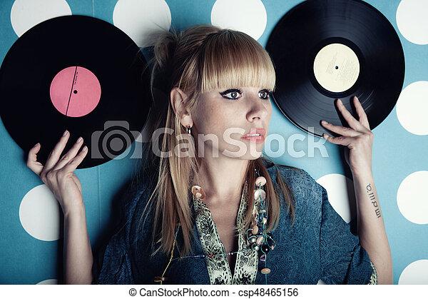 Young beautiful woman with vinyl records - csp48465156