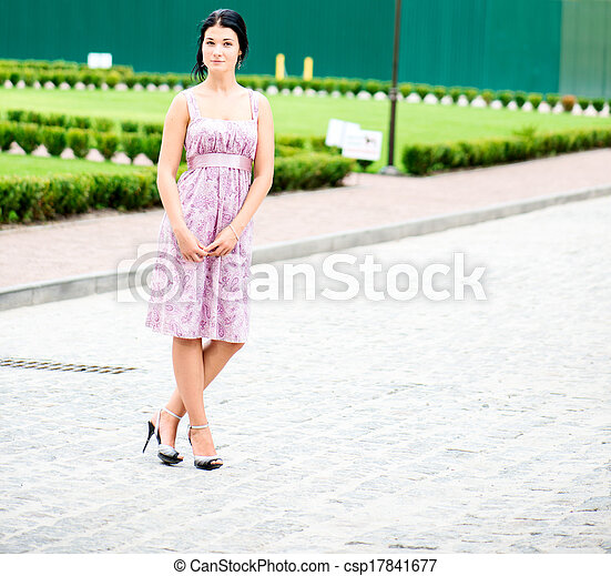 Young beautifull woman standing in a dress - csp17841677