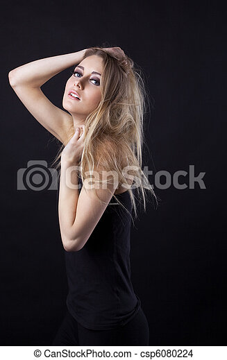 Young beauty blond girl in black dress look at you - csp6080224