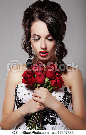 Young Beauty Smelling Bouquet of Red Roses. Pleasure & Harmony - csp17507838