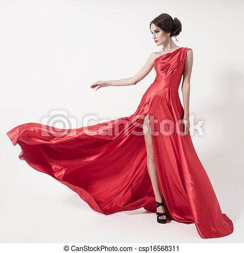 Young beauty woman in fluttering red dress. White background. - csp16568311