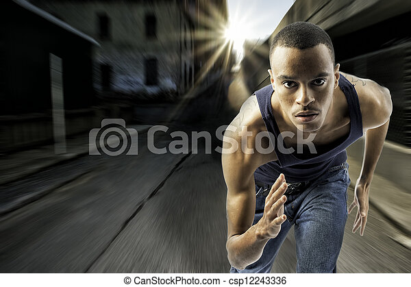 Young black male running in an urban setting - csp12243336