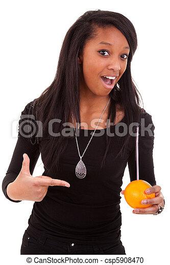 young black woman drinking orange juice  - csp5908470