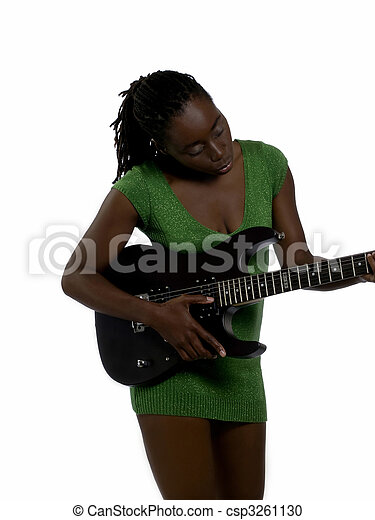 Young black woman green dress with guitar - csp3261130