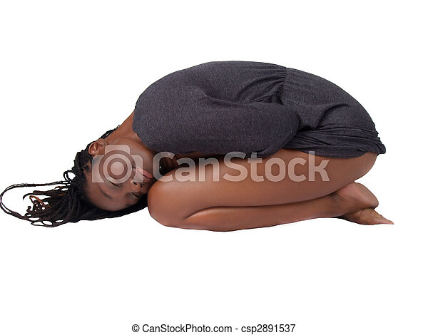Young black woman in gray knit dress on knees - csp2891537