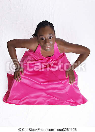 Young black woman in pink dress hands on knees - csp3261126