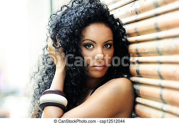 Young black woman in urban background - csp12512044