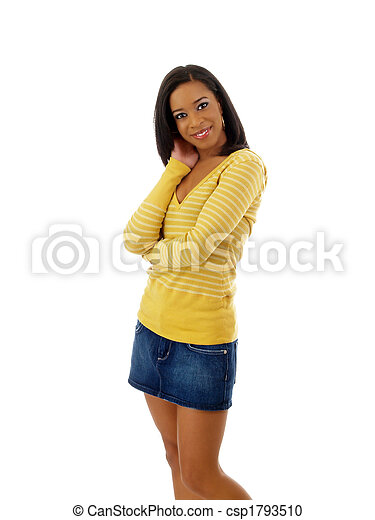 Young black woman in yellow sweater and jean skirt - csp1793510