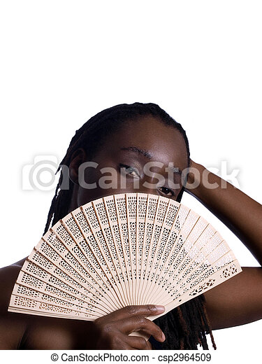 Young black woman portrait with fan covering face - csp2964509