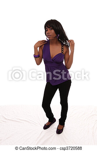 Young black woman purple top jeans standing - csp3720588