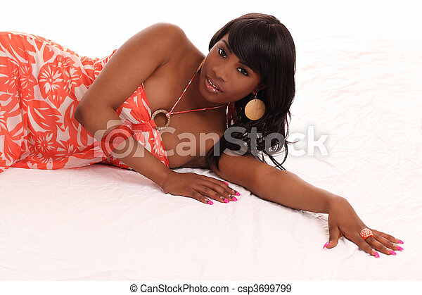 young black woman reclining on floor dress - csp3699799