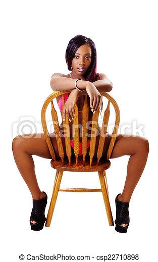 Young Black Woman Sitting Chair Red Bikini - csp22710898