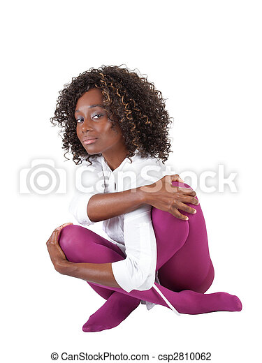 Young black woman sitting in purple tights - csp2810062