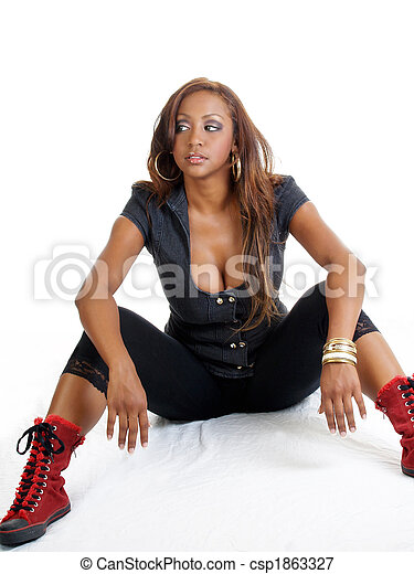 Young black woman sitting with red shoes - csp1863327