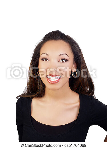 Young black woman smiling with braces on upper teeth - csp1764069