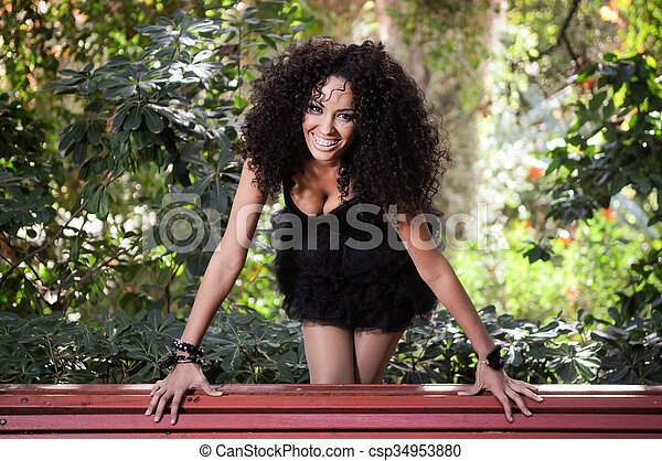 Young black woman smiling with braces - csp34953880