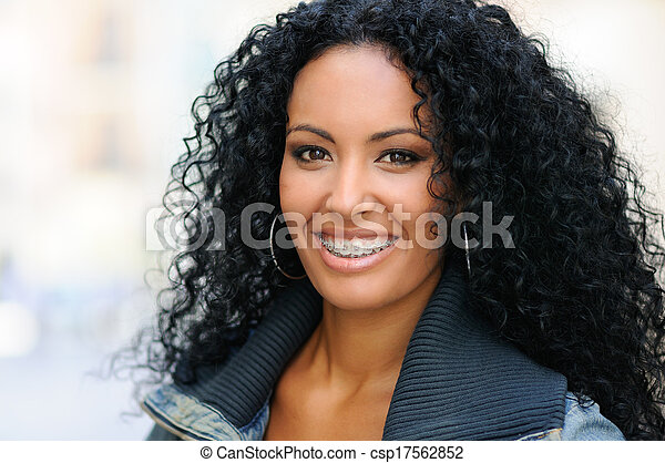 Young black woman smiling with braces - csp17562852