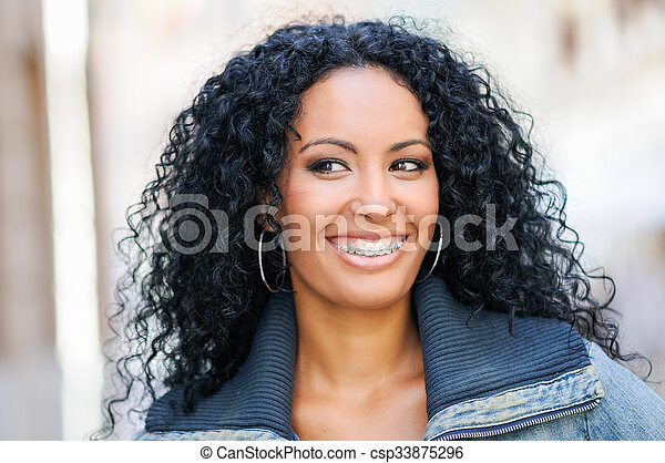 Young black woman smiling with braces - csp33875296