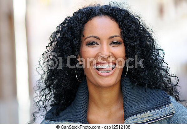 Young black woman smiling with braces - csp12512108