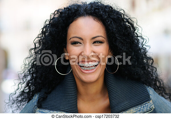 Young black woman smiling with braces - csp17203732