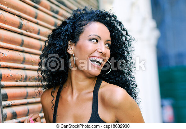 Young black woman smiling with braces - csp18632930