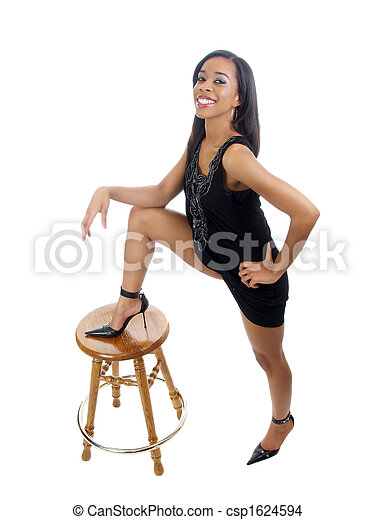 Young black woman with foot on top of stool - csp1624594