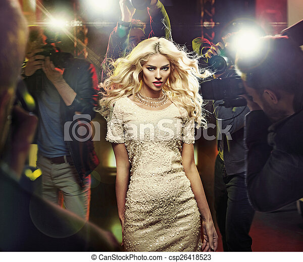 Young blond star among the paparazzi - csp26418523