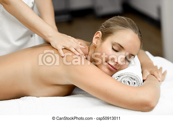 Young Blonde Woman Having Massage And Smiling In The Spa Csp50913011