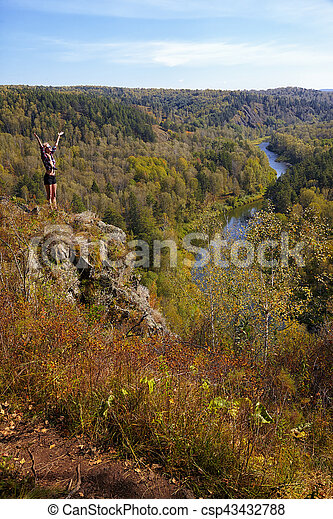 Young blonde woman tourist on a cliff over the river Berd - csp43432788