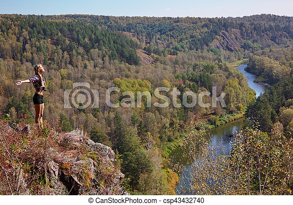 Young blonde woman tourist on a cliff over the river Berd - csp43432740