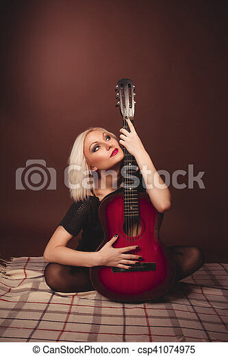 Young blonde woman with guitar - csp41074975
