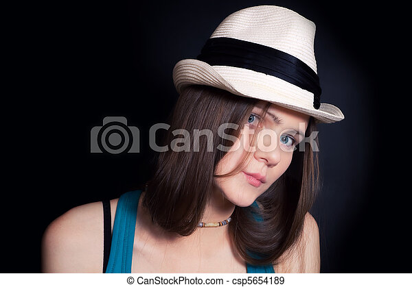young blue-eyed girl in white hat - csp5654189