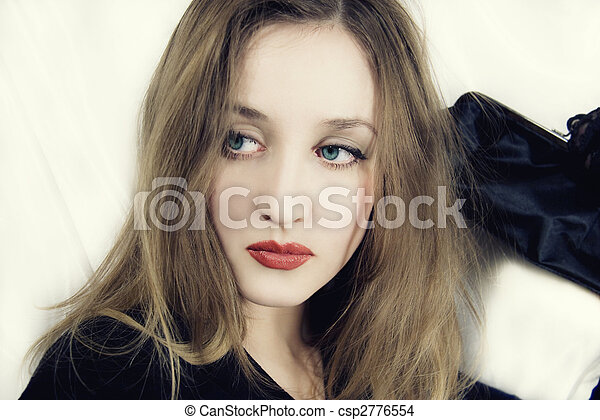 young blue-eyed girl with handbag in hand - csp2776554