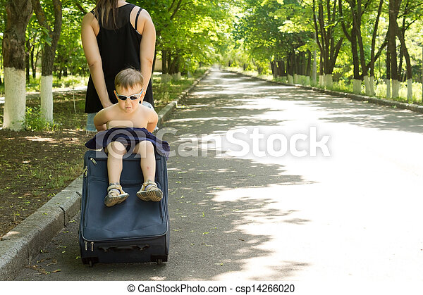 Young boy being carried on a trolley travel bag - csp14266020