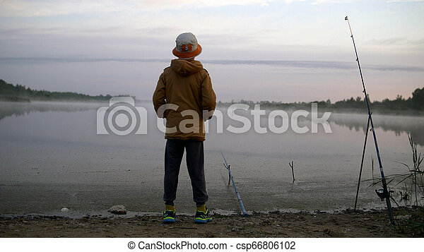young boy fishing in the pond, have fun - csp66806102