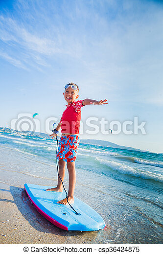 Young boy learning to surf - csp36424875
